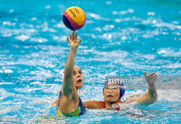 Mariana Duarte of Brazil is challenged by Yating Sun of China during the Women's Water Polo 7th 8th Classification match between Brazil and China on...