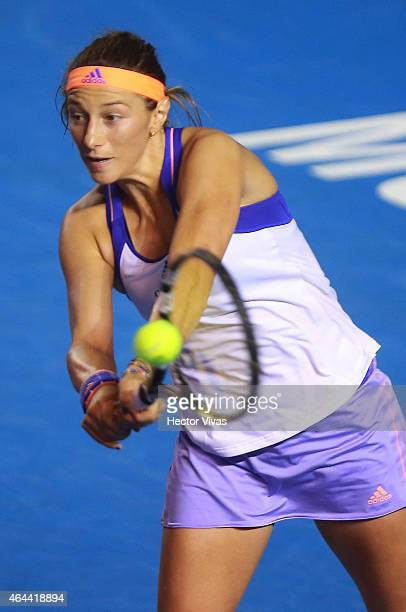 Mariana Duque of Colombia returns a shot against Maria Sharapova os Russia during a women single match as part of Telcel Mexican Open 2015 at...