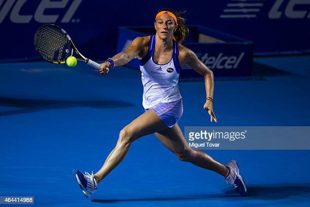 Mariana Duque of Colombia returns a shot during a women's singles match against Maria Sharapova of Rusia as part of Telcel Mexican Open 2015 at...