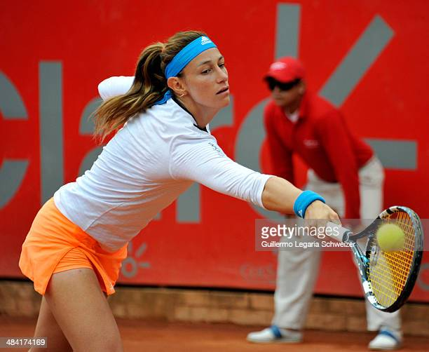 Mariana Duque of Colombia returns the ball to Vania King of US during their WTA Bogota Open quaterfinal match at El Rancho Club in Bogota on April 11...
