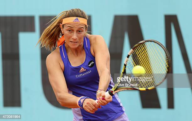 Mariana DuqueMarino of Colombia plays a backhand against Heather Watson of Great Britain in their first round match during day two of the Mutua...