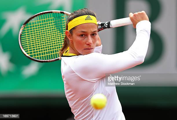 Mariana DuqueMarino of Colombia plays a backhand during her Women's Singles match against Marion Bartoli of France during day six of the French Open...