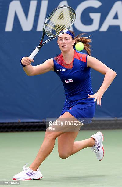 Mariana DuqueMarino of Colombia returns a shot to Ayumi Morita of Japan during Day One of the New Haven Open at Connecticut Tennis Center at Yale on...