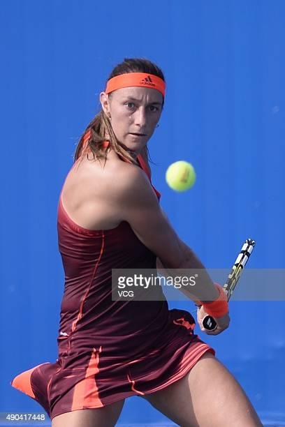 Mariana DuqueMarino of Columbia returns a shot against Anna Karolina Schmiedlova of Slovakia during day two of the 2015 Wuhan Open at Optics Vally...