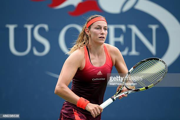 Mariana DuqueMarino of Columbia returns a shot against Sofia Kenin of the United States during her Women's Singles First Round match on Day One of...