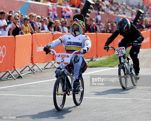 Mariana Pajon of Colombia celebrates winning the Gold medal ahead of Sarah Walker of New Zealand in the Women's BMX Cycling Final on Day 14 of the...