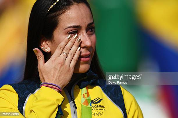 Mariana Pajon of Colombia cries on the podium after being presented with her gold medal after winning the Women's BMX Final on day 14 of the Rio 2016...