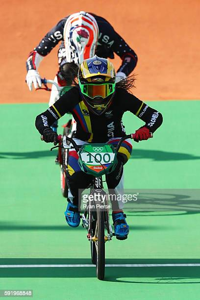 Mariana Pajon of Colombia crosses the finish line to win the gold during the Women's Final on day 14 of the Rio 2016 Olympic Games at the Olympic BMX...