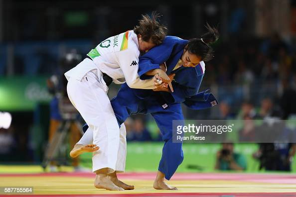 Mariana Silva of Brazil and Tina Trstenjak of Slovenia compete during the Women's 63kg semifinal bout on Day 4 of the Rio 2016 Olympic Games at the...