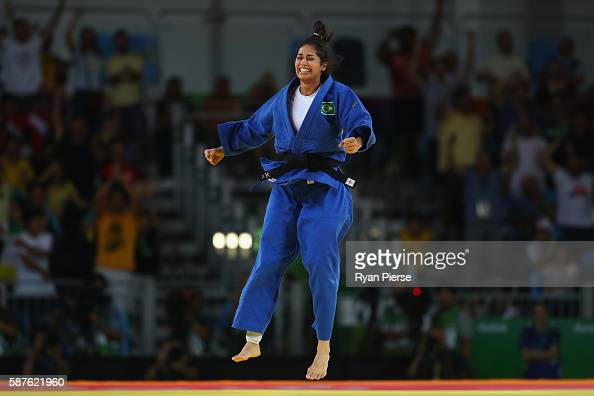 Mariana Silva of Brazil celebrates victory against Yarden Gerbi of Israel during the Women's 63kg quarterfinal bout during Day 4 of the Rio 2016...