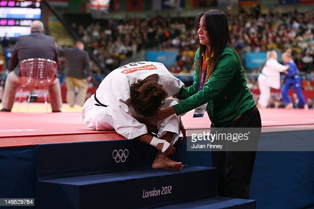 Mariana Silva of Brazil reacts after losing to Hedvig Karakas of Hungary during the Women's 57 kg Judo on Day 3 of the London 2012 Olympic Games at...