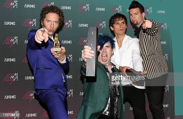 Marianas Trench pose in the press room at the 2013 MuchMusic Video Awards Bell Media Headquarters on June 16 2013 in Toronto Canada