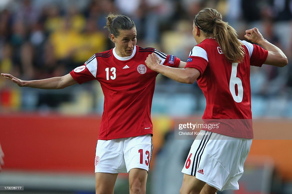 Mariann Knudsen of Denmark (R) celebrates the first goal with Johanna Rasmussen of Denmark (L) during the UEFA Women's EURO 2013 Group A match between Sweden and Denmark at Gamla Ullevi Stadium on July 10, 2013 in Gothenburg, Sweden.