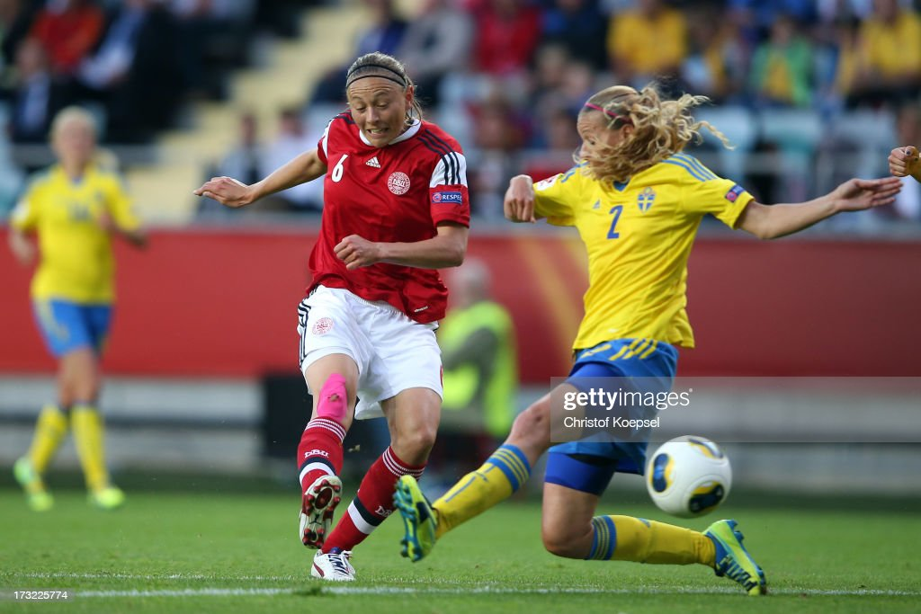 Mariann Knudsen of Denmark scores the first goal against Charlotte Rohlin of Sweden during the UEFA Women's EURO 2013 Group A match between Sweden and Denmark at Gamla Ullevi Stadium on July 10, 2013 in Gothenburg, Sweden.