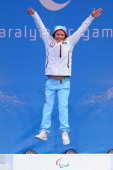 Mariann Marthisen of Norway celebrates on the podium during the medal ceremony for the women's 1km sprint sitting crosscountry during day six of...
