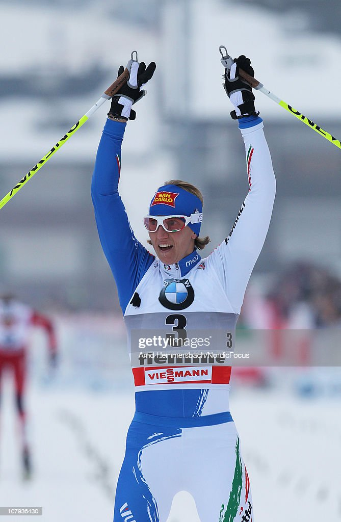 Marianna Longa of Italy celebrates her 3rd place during the mass women for the FIS Cross Country World Cup Tour de Ski on January 8, 2011 in Val di Fiemme, Italy.