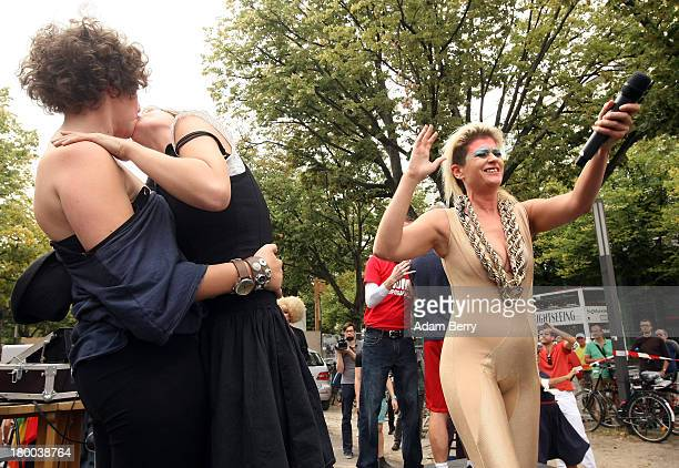 Marianna Salzmann and Nora Haakh kiss as singer Peaches performs in front of the Russian Embassy as part of the 'To Russia With Love' Global KissIn...