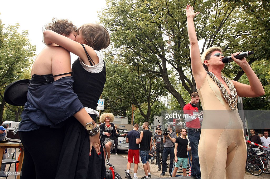 Marianna Salzmann (L) and Nora Haakh kiss as singer Peaches performs in front of the Russian Embassy as part of the 'To Russia With Love' Global Kiss-In on September 8, 2013 in Berlin, Germany. The event was designed to show international solidarity with homosexuals in Russia, currently under pressure from with what is considered by some in societies with more liberal gay rights policies to be homophobic legislation.