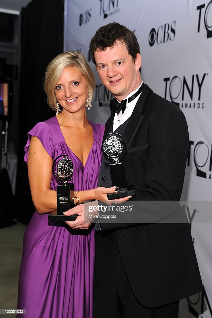 Marianne Elliott and Tom Morris pose with the award for Best Direction of a Play during the 65th Annual Tony Awards at the The Jewish Community Center in Manhattan on June 12, 2011 in New York City.