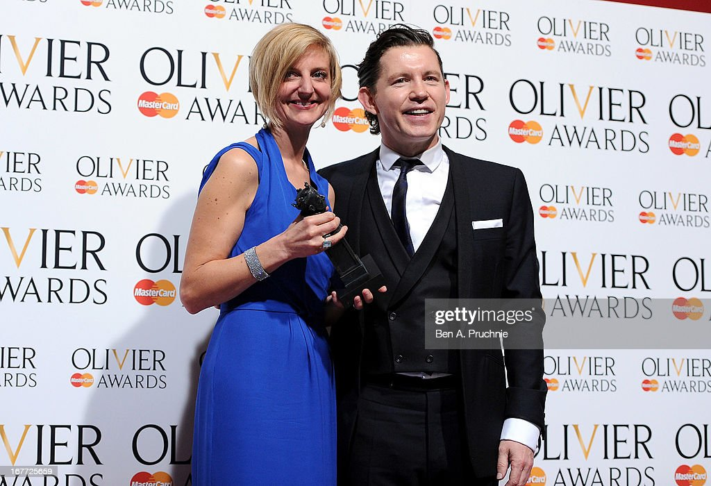 Marianne Elliott with her Best Director award with presenter <a gi-track='captionPersonalityLinkClicked' href=/galleries/search?phrase=Lee+Evans+-+Comedian&family=editorial&specificpeople=15211501 ng-click='$event.stopPropagation()'>Lee Evans</a> during The Laurence Olivier Awards at the Royal Opera House on April 28, 2013 in London, England.