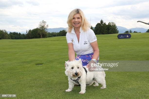 Marianne Hartl and her dog Winnie during the 2nd I'm Living Charity Golf Cup at Golfclub Beuerberg on June 16 2017 in Penzberg Germany The proceeds...