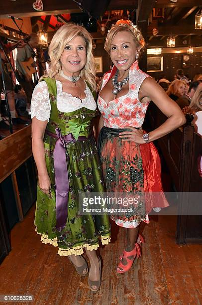Marianne Hartl and Julia Prillwitz attend the Charity Lunch at 'Zur Bratwurst' during the Oktoberfest 2016 on September 27 2016 in Munich Germany