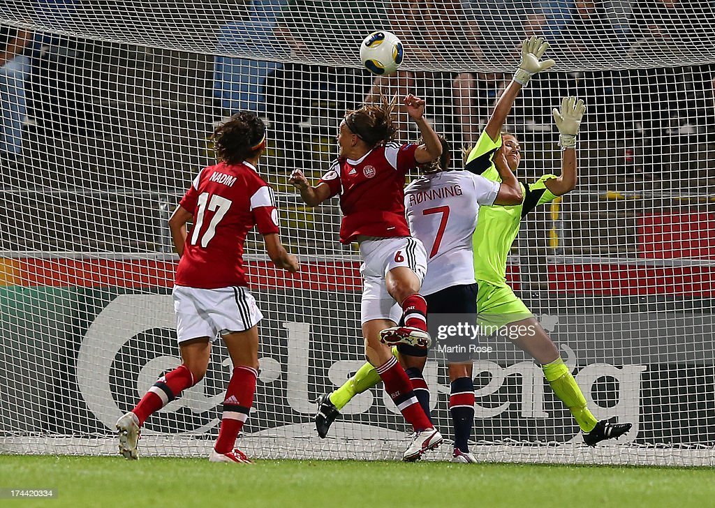 Marianne Knudsen (C) of Denmark heads her team's equalizing goal during the UEFA Women's Euro 2013 semi final match between Norway and Denmark at Nya Parken on July 25, 2013 in Norrkoping, Sweden.