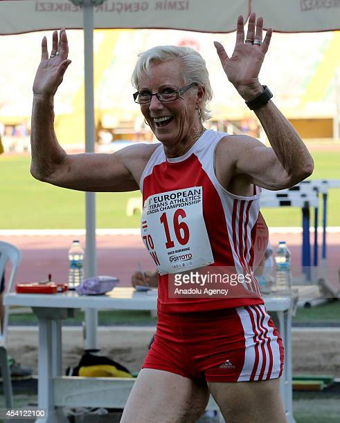 Marianne Maier of Austria reacts after she competes in long jump category at the 19th European Veterans Athletic Championship Stadia 2014 in Izmir in...