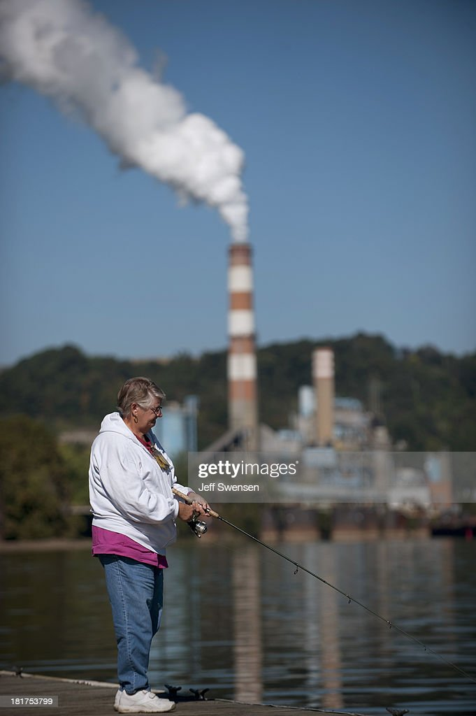 Marianne Patz, 63, fishes upriver from the Mitchell Power Station, a coal-fired power plant built along the Monongahela River, 20 miles southwest of Pittsburgh, on September 24, 2013 in New Eagle, Pennsylvania. The plant, owned by FirstEnergy, will be one of two plants in the region to be shut down, affecting 380 employees. The Evironmental Protection Agency (EPA) and the Obama administration have been taking major steps to get coal-fired power plants into compliance with clean air regulations.