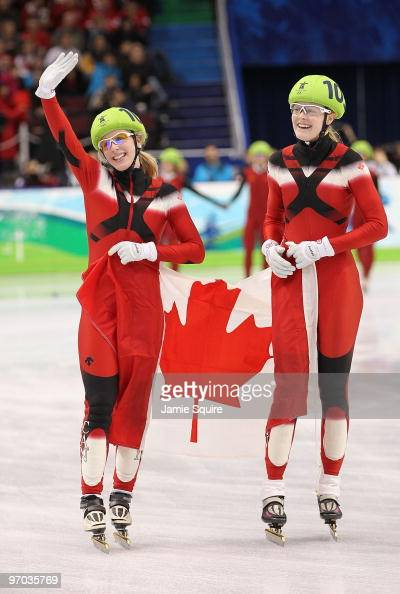 Marianne StGelais and Jessica Gregg of Canada celebrate winning the silver medal in the Short Track Speed Skating Ladies 3000m relay on day 13 of the...
