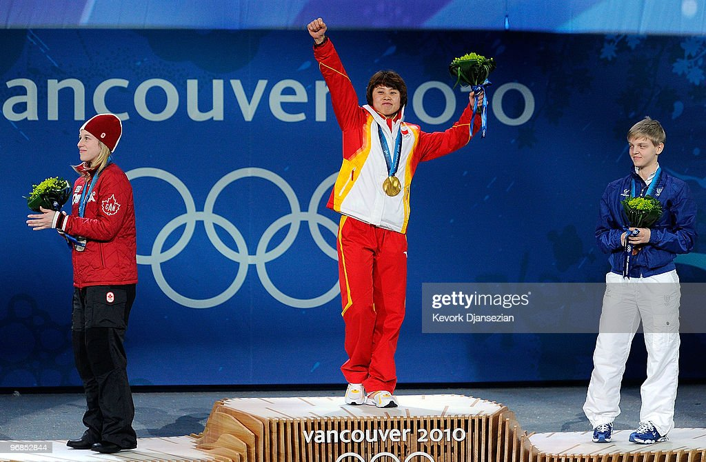 <a gi-track='captionPersonalityLinkClicked' href=/galleries/search?phrase=Marianne+St-Gelais&family=editorial&specificpeople=5579569 ng-click='$event.stopPropagation()'>Marianne St-Gelais</a> of Canada celebrates winning Silver, <a gi-track='captionPersonalityLinkClicked' href=/galleries/search?phrase=Wang+Meng&family=editorial&specificpeople=774285 ng-click='$event.stopPropagation()'>Wang Meng</a> of China, Gold, and <a gi-track='captionPersonalityLinkClicked' href=/galleries/search?phrase=Arianna+Fontana&family=editorial&specificpeople=4680451 ng-click='$event.stopPropagation()'>Arianna Fontana</a> of Italy, Bronze during the medal ceremony for the Ladies' 500 m Short Track on day 7 of the Vancouver 2010 Winter Olympics at BC Place on February 18, 2010 in Vancouver, Canada.