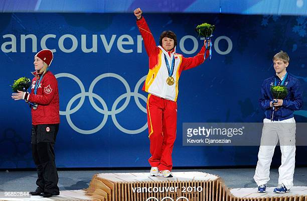 Marianne StGelais of Canada celebrates winning Silver Wang Meng of China Gold and Arianna Fontana of Italy Bronze during the medal ceremony for the...