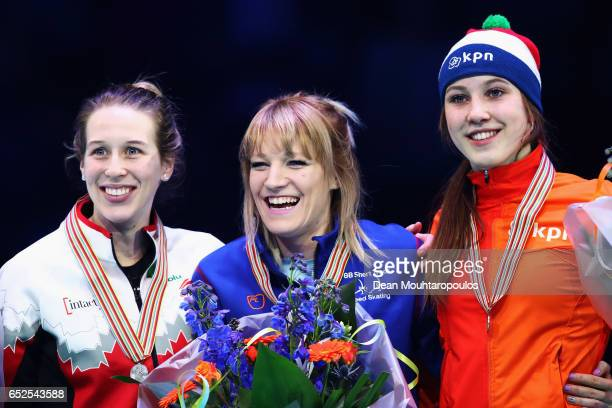 Marianne StGelais of Canada with the silver medal Elise Christie of Great Britain with the gold medal and Suzanne Schulting of Netherlands with the...
