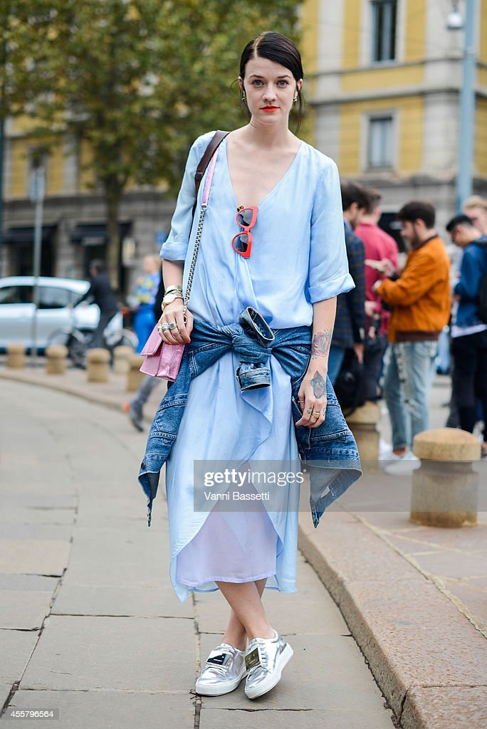 Marianne Theodorsen poses wearing Hunky Dory dress Cala Jade bag Prada sunglasses and Acne shoes on September 20 2014 in Milan Italy