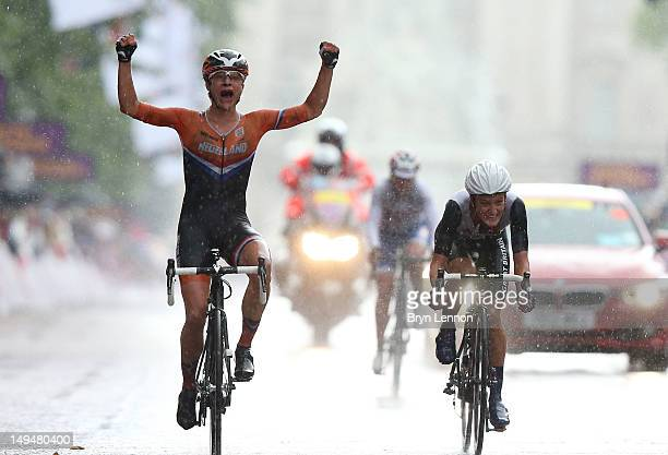 Marianne Vos of Netherlands celebrates as she crosses the finish line ahead Elizabeth Armitstead of Great Britain of to win the Women's Road Race...