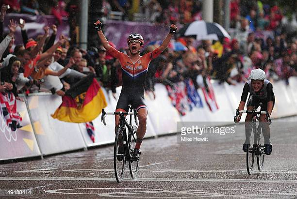Marianne Vos of Netherlands celebrates as she crosses the finish line ahead of Elizabeth Armitstead of Great Britain to win the Women's Road Race...