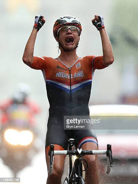 Marianne Vos of Netherlands celebrates as she crosses the finish line to win the Women's Road Race Road Cycling on day two of the London 2012 Olympic...