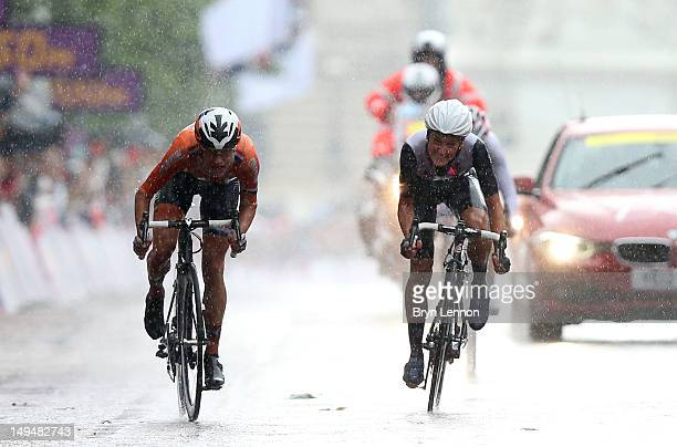 Marianne Vos of Netherlands sprints and crosses the finish line ahead of Elizabeth Armitstead of Great Britain to win the Women's Road Race Road...