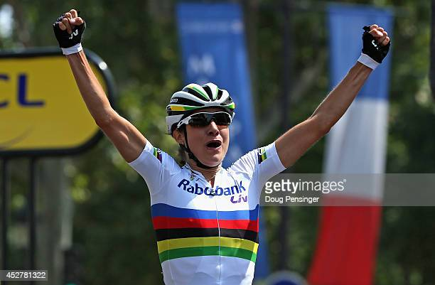 Marianne Vos of the Netherlands and Rabo Liv celebrates as she crosses the line to claim victory in 'La Course by Le Tour de France' on July 27 2014...