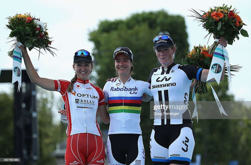 <a gi-track='captionPersonalityLinkClicked' href=/galleries/search?phrase=Marianne+Vos&family=editorial&specificpeople=779313 ng-click='$event.stopPropagation()'>Marianne Vos</a> of the Netherlands and Rabo Liv celebrates victory on the podium with second placed <a gi-track='captionPersonalityLinkClicked' href=/galleries/search?phrase=Kirsten+Wild&family=editorial&specificpeople=5701453 ng-click='$event.stopPropagation()'>Kirsten Wild</a> of the Netherlands and Team Giant-Shimano (R) and third placed Leah Kirchmann of Canada and Optum-Kelly Benefit Strategies (L) following 'La Course by Le Tour de France' on July 27, 2014 in Paris, France. In this historic first edition of the event, female professional riders will race 90km on Champs Elysees prior to the arrival of the Men's Tour de France final stage.