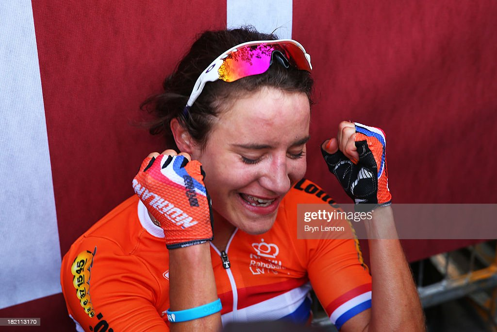 <a gi-track='captionPersonalityLinkClicked' href=/galleries/search?phrase=Marianne+Vos&family=editorial&specificpeople=779313 ng-click='$event.stopPropagation()'>Marianne Vos</a> of the Netherlands celebrates after winning the Elite Women's Road Race on September 28, 2013 in Florence, Italy.