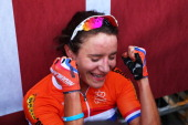 Marianne Vos of the Netherlands celebrates after winning the Elite Women's Road Race on September 28 2013 in Florence Italy