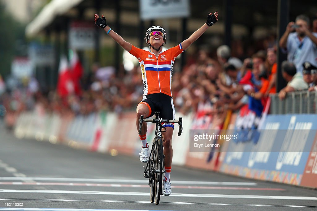 <a gi-track='captionPersonalityLinkClicked' href=/galleries/search?phrase=Marianne+Vos&family=editorial&specificpeople=779313 ng-click='$event.stopPropagation()'>Marianne Vos</a> of the Netherlands celebrates crossing the finish line to win the Elite Women's Road Race on September 28, 2013 in Florence, Italy.