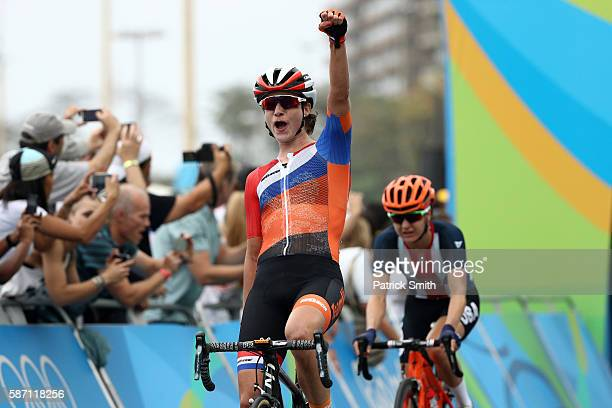 Marianne Vos of the Netherlands celebrates for her teammate as she finishes ahead of Megan Guarnier of the United States during the Women's Road Race...