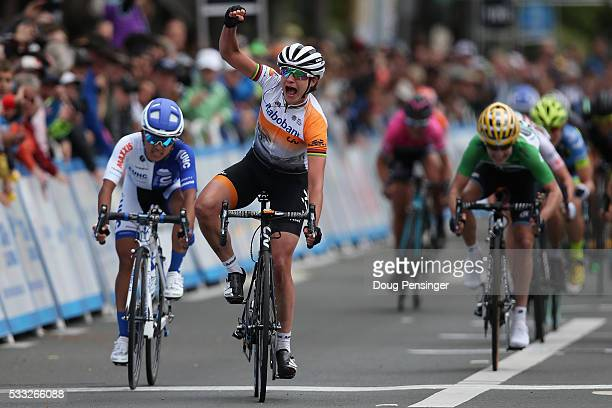 Marianne Vos of The Netherlands riding for RaboLiv Women Cycling Team celebrate her victory ahead of Coryn Rivera of the United States riding for...