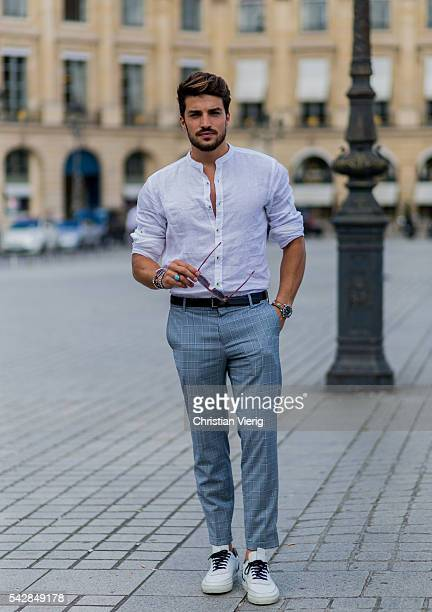 Mariano Di Vaio wearing a white button shirt and grey pants and white sneakers outside Cerruti during the Paris Fashion Week Menswear Spring/Summer...