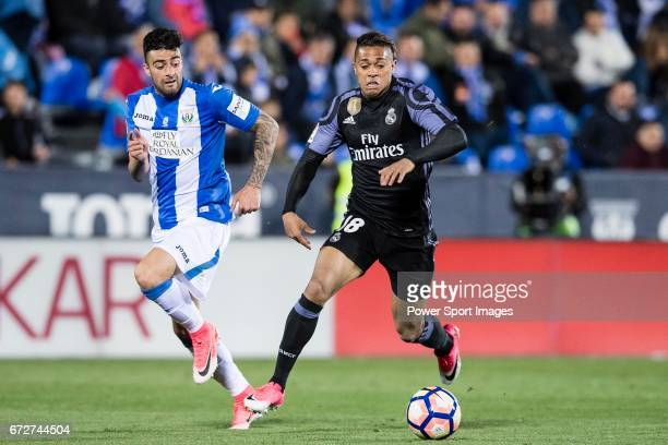 Mariano Diaz Mejia of Real Madrid battles for the ball with Diego Rico of Deportivo Leganes during their La Liga match between Deportivo Leganes and...