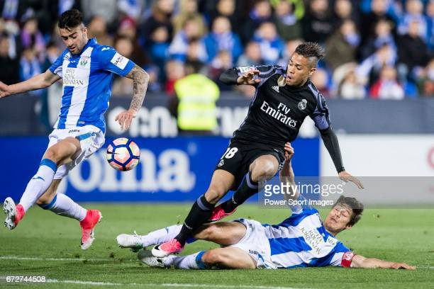 Mariano Diaz Mejia of Real Madrid battles for the ball with Diego Rico and Martin Mantovani of Deportivo Leganes during their La Liga match between...