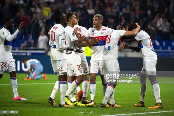 Mariano Diaz of Lyon celebrates with teammates after a score of Nabil Fekir during the Ligue 1 match between Olympique Lyonnais and AS Monaco at...