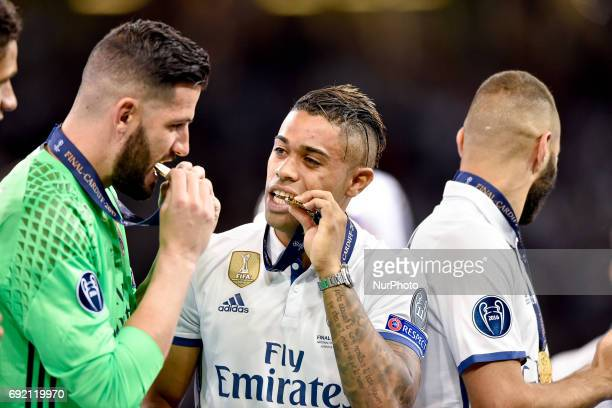 Mariano Diaz of Real Madrid celebrate the victory with Francisco Casilla of Real Madrid during the UEFA Champions League Final match between Real...